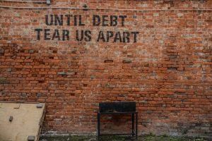 Should Spouses Be Held Accountable for Business Debt?